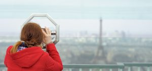 Young woman on observation deck in Montparnasse building in Paris, France